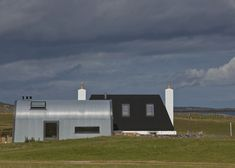 Denizen Works has overhauled a cottage in Scotland's Outer Hebrides by rebuilding the old structure and adding extensions modelled on agricultural sheds. British Architecture, Space Architecture, Architecture Details, Bungalow, Cottages Scotland, Silo House, Quonset Hut, Dome House, Floating House