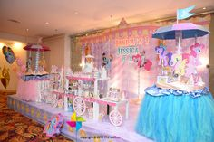 A pretty and sweet My Little Pony Carousel birthday party for 2 lovely girls! The whole backdrop and candy buffet setup on stage was designed by ParteeBoo - The Party Designers