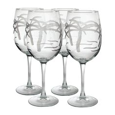 Add a tropical touch to your soiree with palm tree etched wine glasses. #jossandmain.