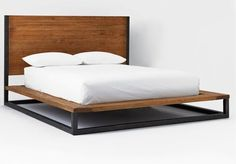 From West Elm description: Lofted on an iron base, the substantial Industrial Bed is made of solid wood that's been hand-planed to create a distressed look. Both rustic and refined, it has a g...