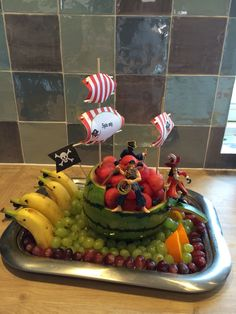 Pirate ship watermelon carving, fruit dolphins.