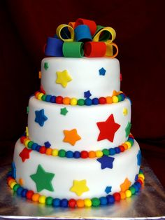 Rainbow Stars - For my niece and nephew's joint birthday party.  They will be 5 and 1.  All decorations are fondant.  The smash cakes and the top layer are funfetti and the rest of the cake is white chocolate WASC.  The cake reminds me of Skittles.