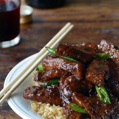 Mongolian Beef Over Rice - Flank steak with garlic, soy sauce, brown sugar and scallions. Over rice it is terrific!!