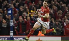 Wales' wing George North runs in to score a try during the Six Nations match against Scotland in Cardiff