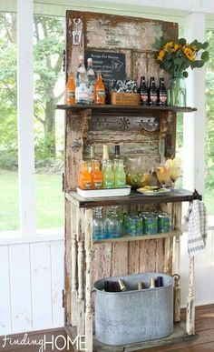 Love this idea! Old door turned into a beverage serving station.