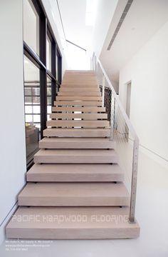 Elegant European hardwood floors  #pacifichardwoodflooring #hardwoodfloors #EuropeanOak #Whitewash #modernfloors #floors #elegant #ourwork #stairs #floatingstairs #wideplanks
