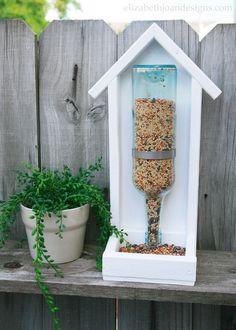 Wine Bottle Bird Feeder Think twice before tossing that empty wine bottle! Instead, repurpose it in the cutest mobile bird feeder. Get the tutorial at Elizabeth Joan Designs.