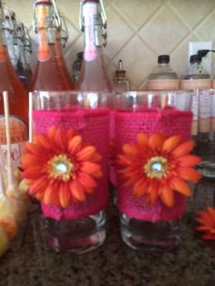 50th party DIY glasses from dollar store hot pink burlap, flowers from Micheals and a little hot glue gun these beauties light up tables beautifully. Gave a cozy feeling candles scented with floral scent made the outdoors smell original!
