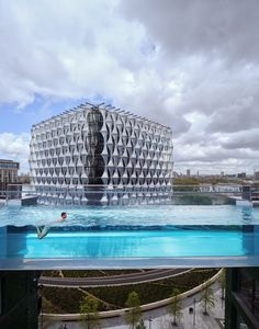 """Architecture studio HAL has created a transparent swimming pool bridge between two buildings at the Embassy Gardens development in Battersea, London. Named Sky Pool, the 25-metre-long swimming pool is made entirely from acrylic panels, allowing swimmers to look directly down to the ground 35 metres below. HAL designed the pool, described by the studio as the world's first, to be a structure with """"a sense of fun"""" that gives people """"a swim like no other"""". London House, London Street, Pool Bridge, Sky Pool, London Now, Natural Swimming Pools, Swimming Pool Designs, Future City, World"""