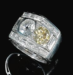 DIAMOND RING, BULGARI, CIRCA 1940. Set with circular-cut diamonds of brown and near colourless tint, trilliant and baguette diamonds, size 551/2, partially signed Bulgari.