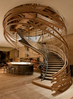 Interior Design Magazine: Jouin Manku designed this modern meets farmhouse staircase for the recently renovated Brasserie les Haras in Strasbourg, France. Royal Studs: Jouin Manku Renovates Former Lo Interior Design Magazine, Wooden Staircases, Stairways, Wooden Stairs, Spiral Staircases, Winding Staircase, Curved Staircase, Painted Stairs, Strasbourg