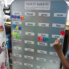 Word wall center, children read the word to a partner, then build the word with the magnet letters. This is made with a large oil drip pan from an auto parts store:)