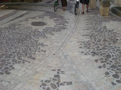 Stone sett and cobble paving, beautifully detailed surface water channels; Uzes, France
