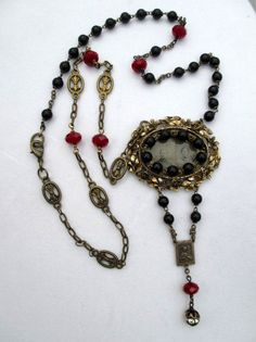 Check out this item in my Etsy shop https://www.etsy.com/listing/230907250/handmade-assemblage-tin-type-rosary