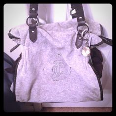 Juicy Couture handbag Light gray and brown trim. Super adorable bling dangle. Has a few worn spots.  Price negotiable Juicy Couture Bags