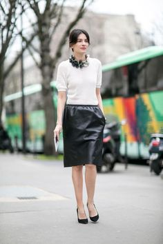 Chic Street Style From Paris Fashion Week - Ribbed eggshell white sweater worn with a sleek black leather pencil skirt and classic pointy toe pumps