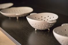 Masanobu Ando colander with a hole to hang when not being used.
