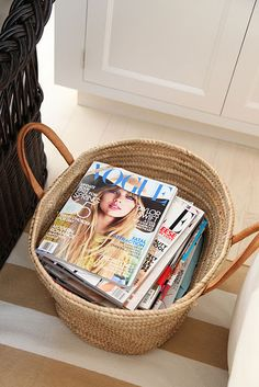 Keep your magazines in an old tote bag to make them look chic and to keep them organized!