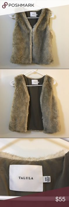 Talula faux fur vest Super soft faux fur vest perfect for winter season! Has hooks and inseam pockets. Keeps you warm without sacrificing your style. Aritzia Jackets & Coats Vests