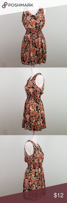 """Living Doll LA rose floral print dress Sz L Good gently used condition. Elastic waist band. Made in USA.  Approximate measurements (garment laying flat): -Length 34.5"""" -Bust 20"""" armpit to armpit   6 living doll Dresses Midi"""