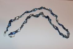 Eyeglass Holder Chain Crochet Necklace Blue Silver Yarn ** Discover this special product, click the image : Handmade Gifts Teacher Discounts, Eyeglass Holder, Necklace Holder, Couple Shirts, Pin Image, Mens Tees, Blue And Silver, Eyeglasses, Crochet Necklace