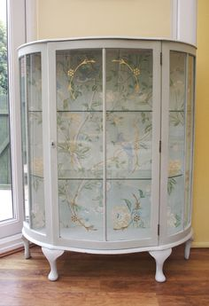 Glass Display Cabinet painted in Annie Sloan ROCOCO (Old White/Duck Egg Blue) with Laura Ashley fabric back