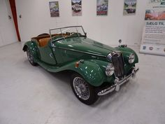 1954 MG TF1250     Early original left-hand drive MG TF with odometer in kilometers. The car has its original Almond Green metallic paint and its original 1250 cc engine. The car drives and stop as is should and is in great mechanical condition. The car belonged to Danish actor Ebbe Langberg in the 1960's and later the editor of the Danish newspaper BT Morten Petersen.  - K266 Green Metallic Paint, Newspaper, Danish, Cars For Sale, Editor, Antique Cars, Engine, Almond, Classic Cars