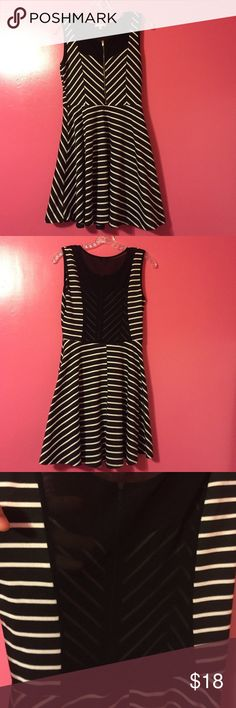 Black & white striped dress with mesh back size M Black and white striped dress with a working zipper in the front. See-through mesh back in pretty good condition. No stains or holes! Some pelleting but only noticeable when being closely inspected. Zipper is slightly discolored. Dresses Mini