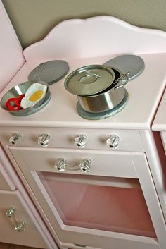 When I was little I had a green play kitchen that I use to love , it was made of metal with the burners painted on it ( insert old age joke,. Pink Play Kitchen, Best Play Kitchen, Diy Kitchen, Play Kitchens, Pottery Barn Kitchen, Tool Bench, Pottery Barn Inspired, Glass Knobs, Little Girl Rooms