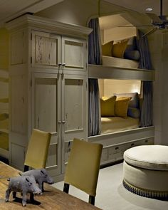 Love the built in bunks, with the big custom cabinet too...nice for kids' or guests' room, especially for vacation homes or someone with lots of grandkids. The design of this set makes the beds feel wonderfully cavelike and cozy—unless you're claustrophobic, of course.