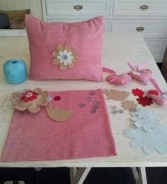 Things to do with our felt cut outs - sew a big, lavish pin cushion, or embellish a scatter, or a lavender bag. Also add to plain curtain tiebacks, sew a row of flowers or birds to make a border at the top or hem of a curtain, glue onto a headband. Or sew a couple together, back to back, and glue a brooch pin on the back.