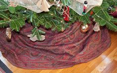 Antique paisley shawl being used as a Christmas tree skirt by kizilod2, via Flickr