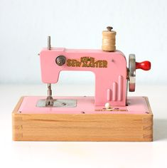 A vintage pink sewing machine.