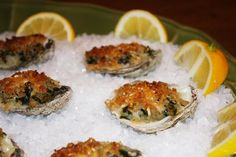 [oysters rockefeller] oysters topped with spinach, breadcrumbs and parmesan cheese