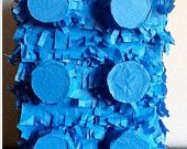 Rather than filling it with candy and junky trinkets, have lightweight Lego pieces falling out.