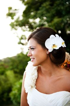 Two gorgeous phalaenopsis orchids tucked into the bride's hair = lovely!  Photo :: Christie Pham Stylist :: Maleana