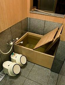 A private furo in a ryokan Bathing is an important part of the daily routine in Japan. Baths are for relaxing, and the body must be cleaned and scrubbed before entering the bathtub or furo. This is normally done at a small faucet or shower located in the same room as the tub, while seated on a small stool. A traditional Japanese bathtub is square, and deep enough that the water will cover the shoulders, but requires the bather to sit with the knees drawn up to the chest. The tub water is…