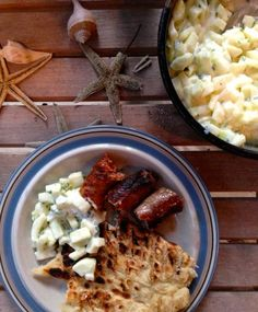 Grilled sausages with cucumber raita and grilled flatbread