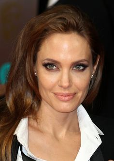 Angelina Jolie sported a subtle smoky eye and sideswept waves at the BAFTA Awards.