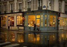 Mother and baby strolling the beautiful back streets of Paris on a rainy evening - not a tourist in sight!