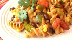 Pasta is tossed with a zesty dressing of lime juice, chili powder and cumin. Corn, black beans, red and green bell pepper, tomatoes and cilantro add texture, flavor and color.