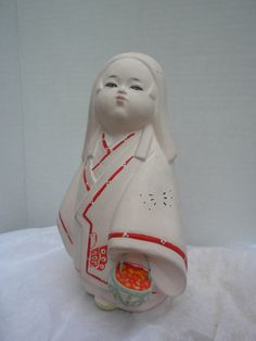 """pink mystery woman figurine with basket, 7"""" tall, ceramic, hand painted. $25.00, via Etsy."""