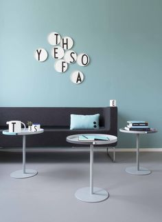 Design Letters plates and Table to go, designed by Christian Flindt. Cool interior design with turquoise wall and graphic porcelain pieces.
