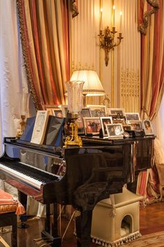 Family photographs rest on a grand piano in Joan Rivers' New York City apartment.