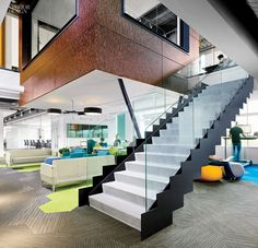 Coalesse Visalia Lounges create a comfortable lounge space at the base of the stairs at SurveyMonkey. Design by Tim Murphy Design Associates.