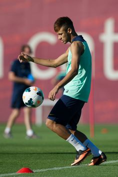 Neymar of FC Barcelona juggles the ball during training session at the Sant Joan Despi Sport Complex on July 29, 2013 in Barcelona, Spain.