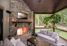 This rear porch features a fireplace for cozy evenings! The Carrera #1178. http://www.dongardner.com/house-plan/1178/the-carrera. #Porch #OutdoorLiving #DreamHome