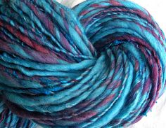 "SheepingBeauty on Etsy. ""Waterberries"" multi-fiber single-ply yarn, hand-spun from fiber prepared by Nunnaba on Etsy. Aquas, blues, purples."