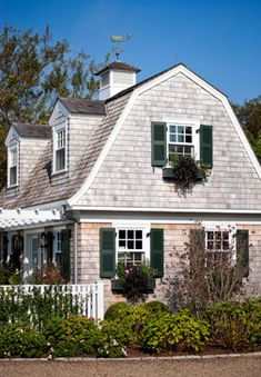 1 This roof style has characteristics like curved eaves along the length of the house. It would go well with a dutch colonial style home.