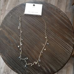 Loft long gold tone opaque necklace Loft long gold tone opaque necklace. Length is 35 inches. With crystals drops. LOFT Jewelry Necklaces